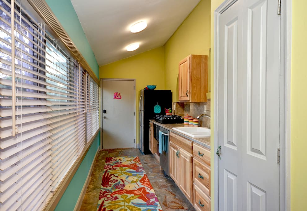 "Front door enters directly into ""kitchen"""