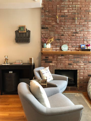 First floor sitting area with west elm chairs.  Electric fireplace makes it extra cozy during the winter!