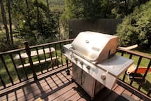 BBQ Grill on the covered porch by the hot tub, filled  propane tank is provided