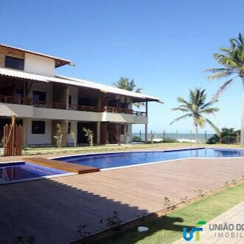 Charming flat in front Of the sea. Pé na areia!