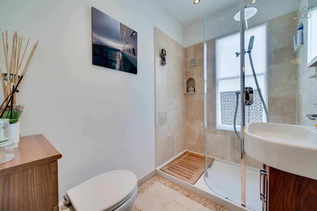 Squeaky-clean, recently renovated, modern bathroom.