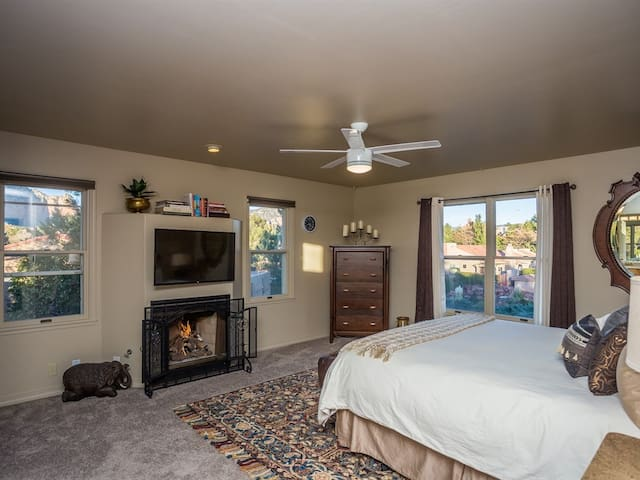 Roomy Master bedroom features fireplace, HDTV, views, large closet