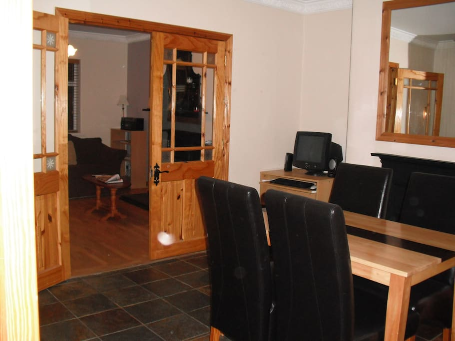 Dining area leading to Sitting room.