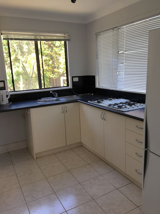 Self contained kitchen with large fridge.