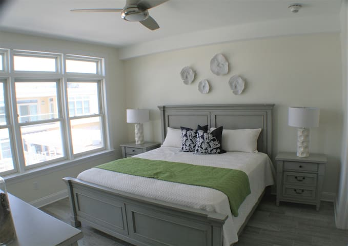 King Size Master bed.   Window treatments are not in when this photo was taken