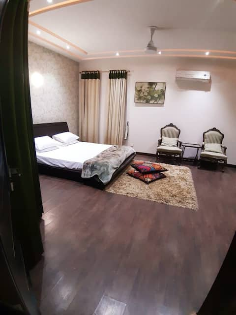 Big and spacious bedroom with attached bathroom.