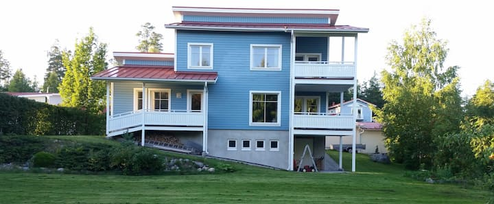 Big house near by lake.