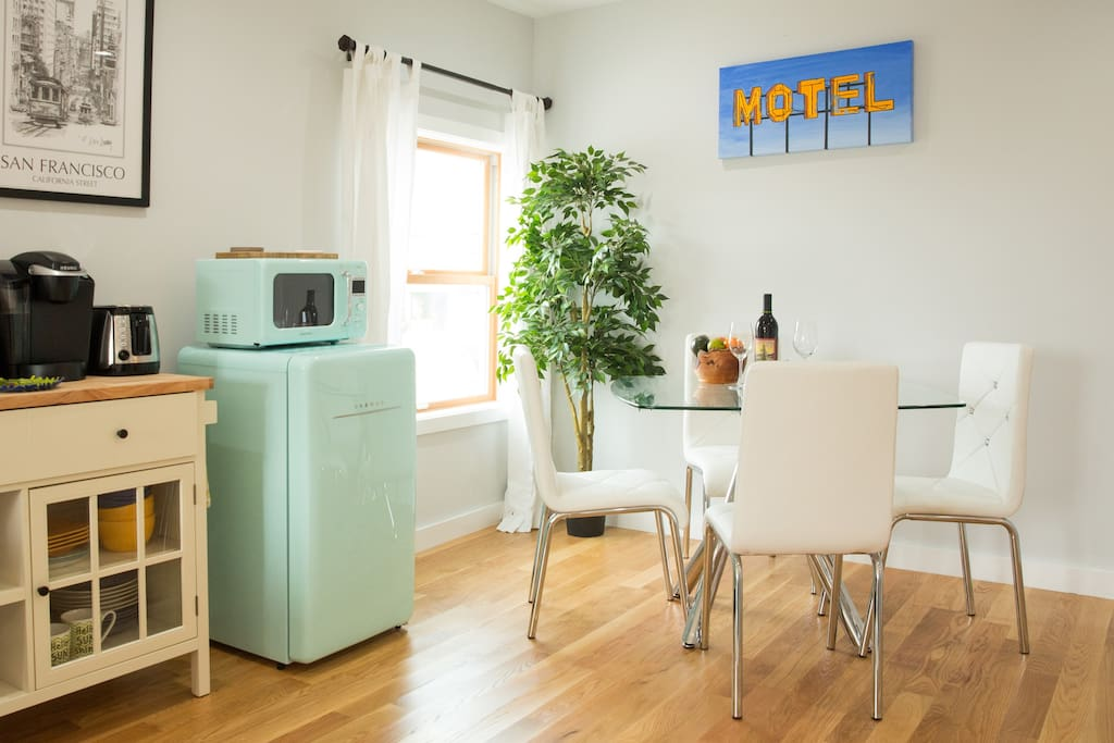 Kitchenette with mini fridge, microwave, toaster, coffee maker, cutting board/cheese board, dishes, glassware, and utensils, etc.