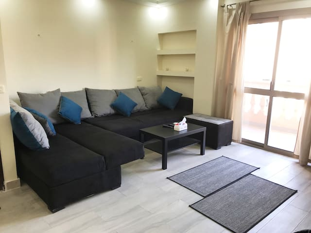 Living Room with L-shape sofa bed