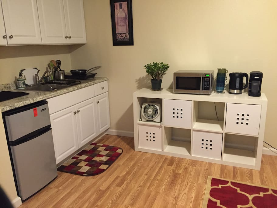 Kitchenette, with fridge & freezer, toaster over, plus coffee maker, microwave and induction cooktop for cooking