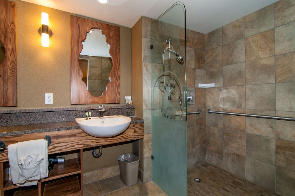 The spacious bathroom features a stunning shower and a variety of amenities for ease of access.