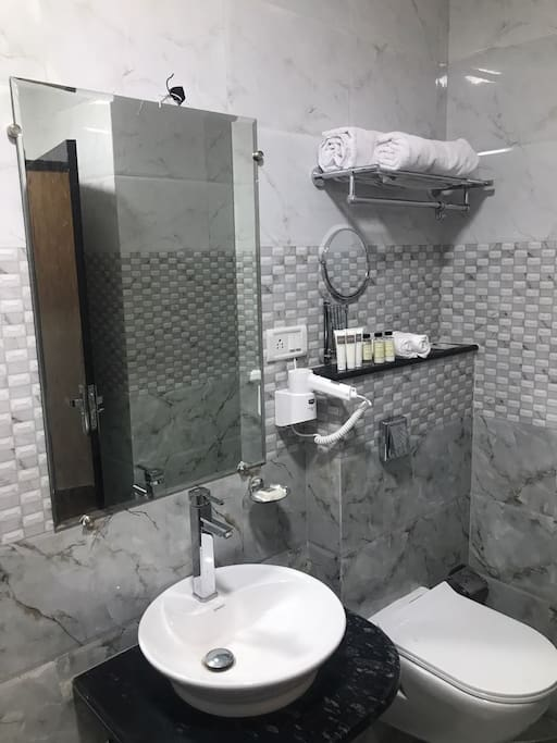 Toilet amenities with shaving mirror and hair dryer