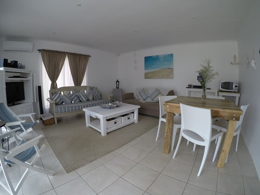 Comfortable lounge and dining area, with sleeper couch ( double bed size)
