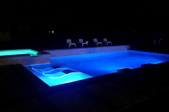 Turn on the colorful pool lights once the sun goes down