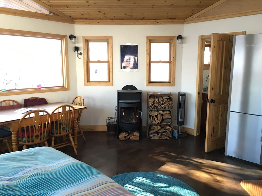 View from the entrance of the award winning environment friendly design. Consider your stay here as similar to having a custom crafted 374 square foot hotel room with queen bed, a full kitchen with oven, Liebherr fridge, full bathroom, indoor/outdoor Bose surround sound, unlimited wifi, HDTV and dining table. And that's just on the inside! Outside is a garden paradise!