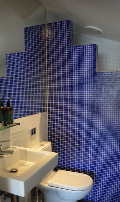 A stylish ensuite bathroom with shower.