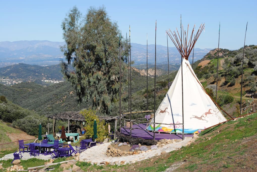 Outdoor seating area below tipi, amazing views.