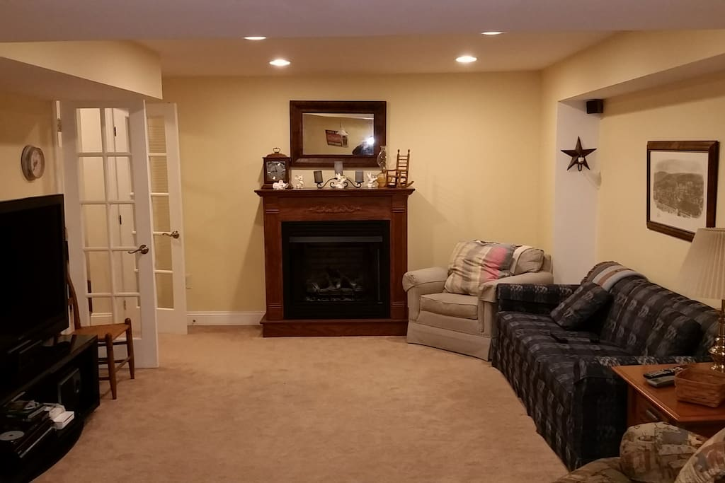 Living Room in our basement. TV, sofa, recliner fireplace