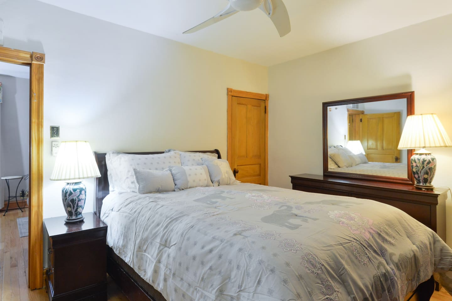 Comfortable queen size bed in a bright and spacious master bedroom