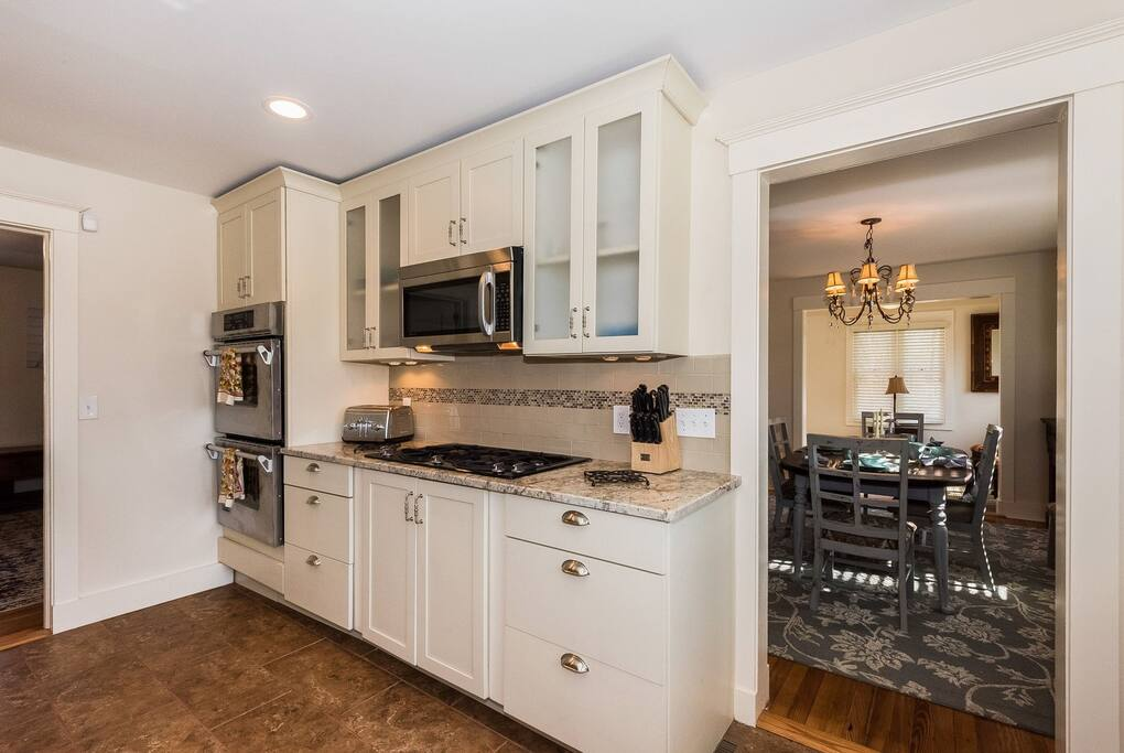 Modern Kitchen with granite counter tops and Jenn Air appliances