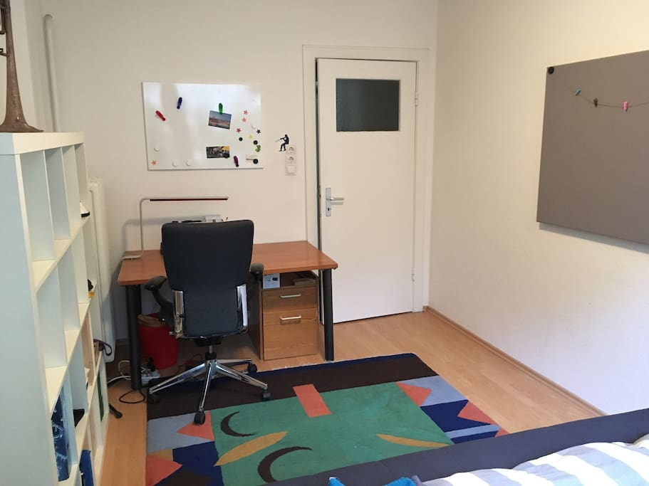 Bright room with bed and desk