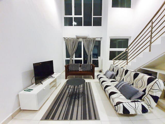 Lounge area with sofabed; Smart TV equipped with Netflix, YouTube, HyppTV, browser etc. for hours of entertainment