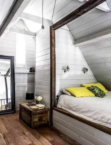 Queen Size bed in mezzanine with walk in wardrobe