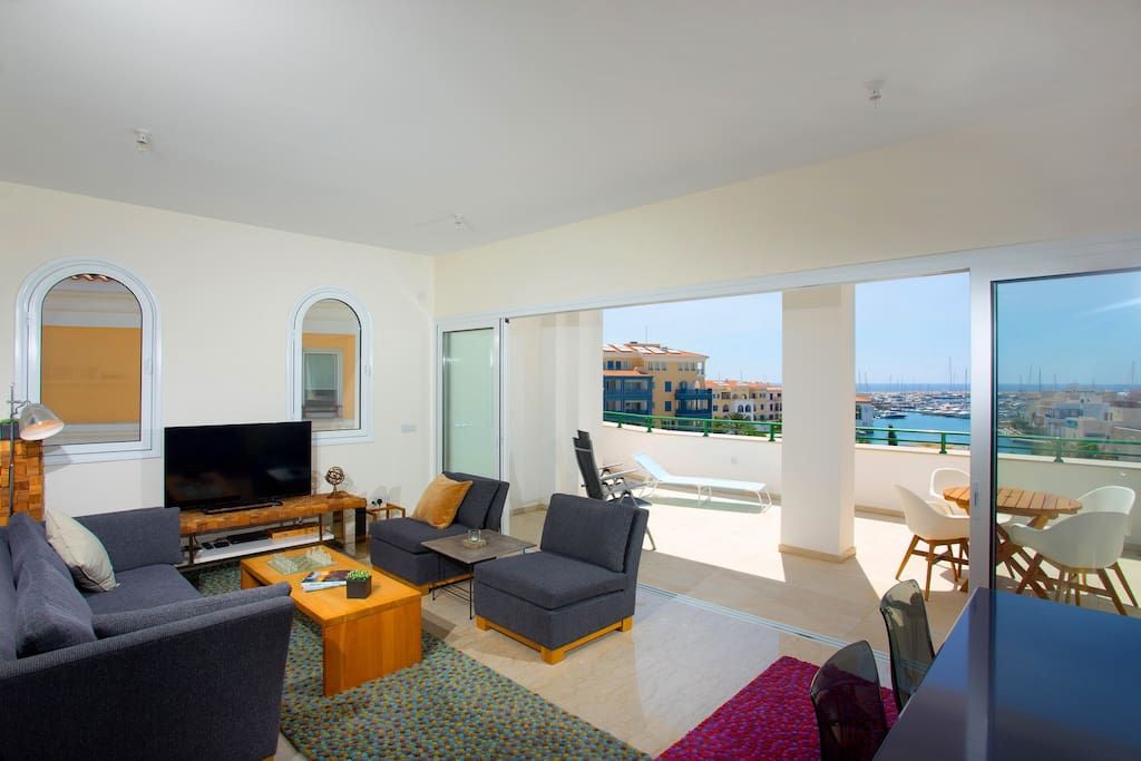 Panoramic windows open on to the terrace