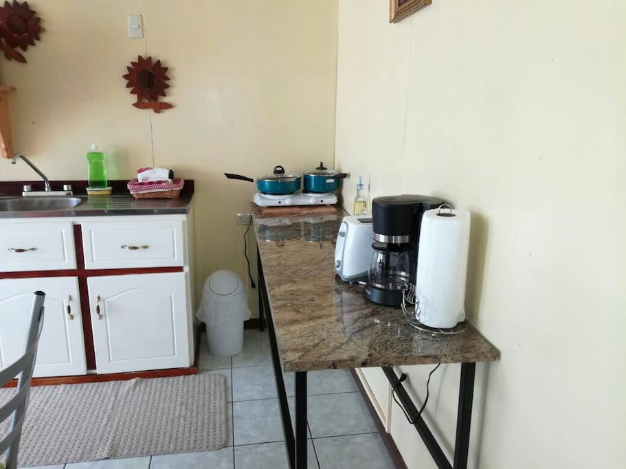 Coffee maker, rice cooker, toaster and kitchen utensils.