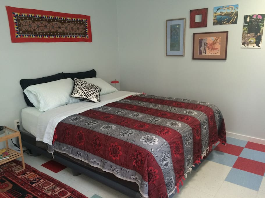 New queen bed for couple with twin airbed available for extra guest.