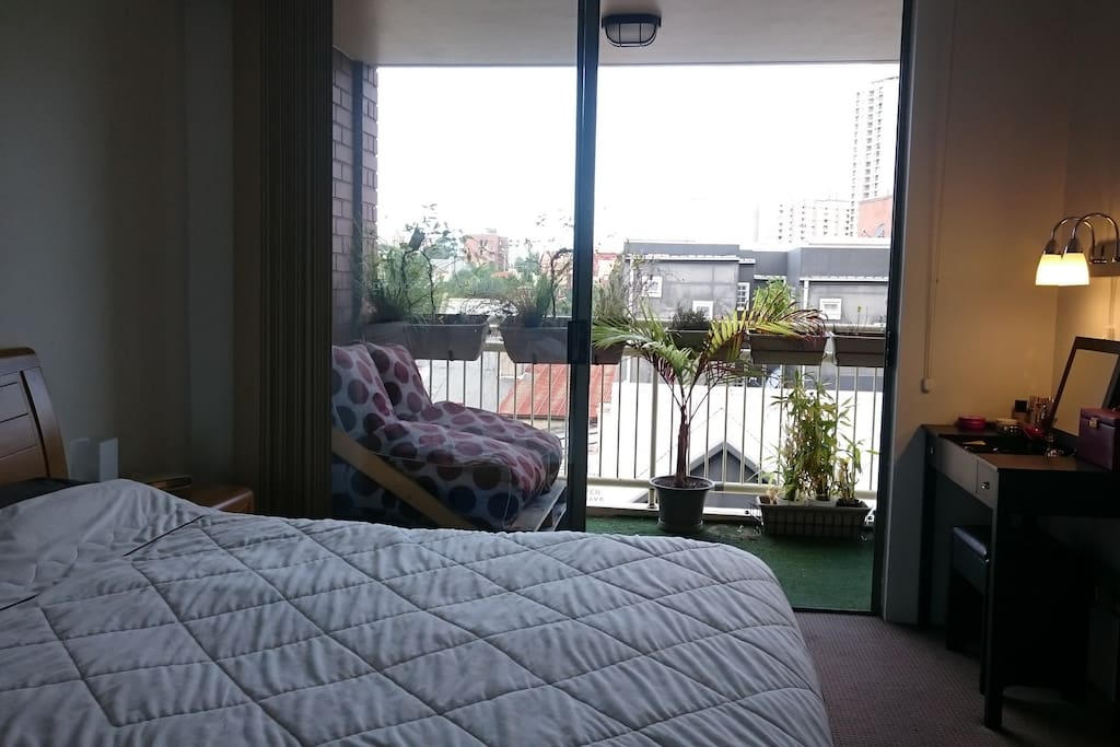 Master bedroom with view on to the balcony