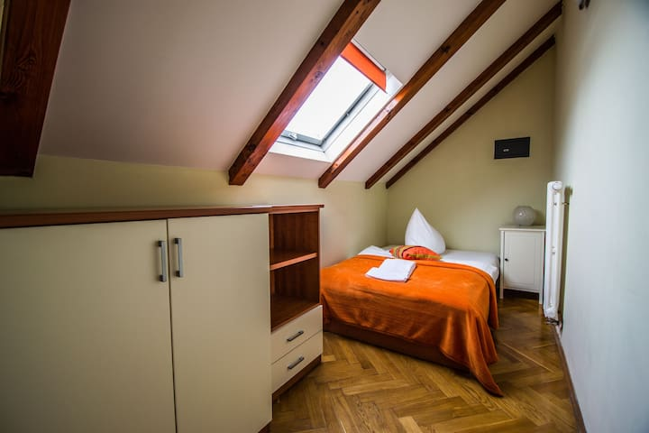 first bedroom with double bed and wardrobe for 2 guests