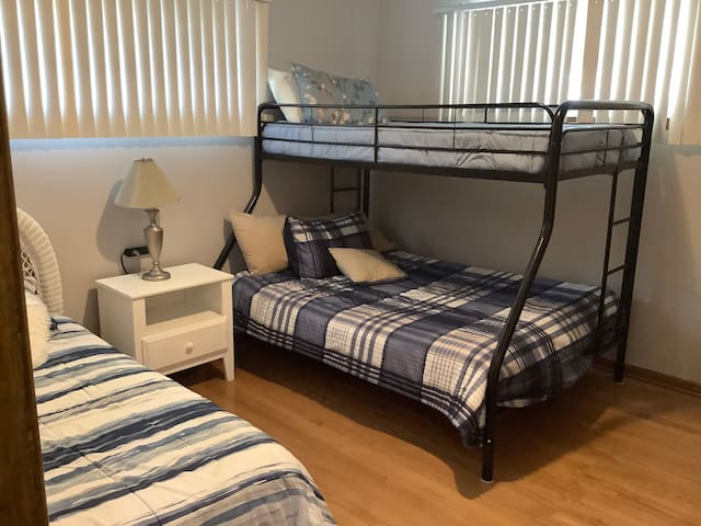 """""""Kids"""" room. 2 twin beds, full size, bonus rollaway twin bed, pack-n-play in the closet. Lots of extra pillows and blankets in the closets of each bedroom"""