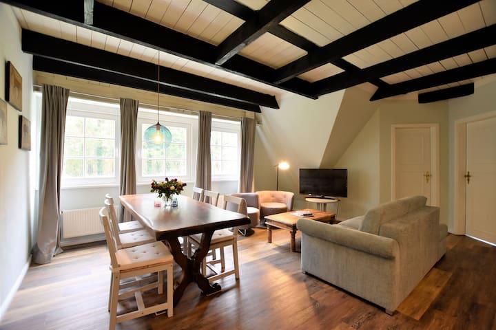 Apartment Johann in thatched cottage with outdoor sauna, garden, playground