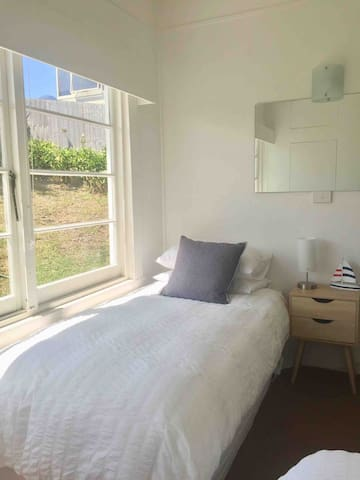 3rd bedroom. 2 single beds. Space for 1 portacot