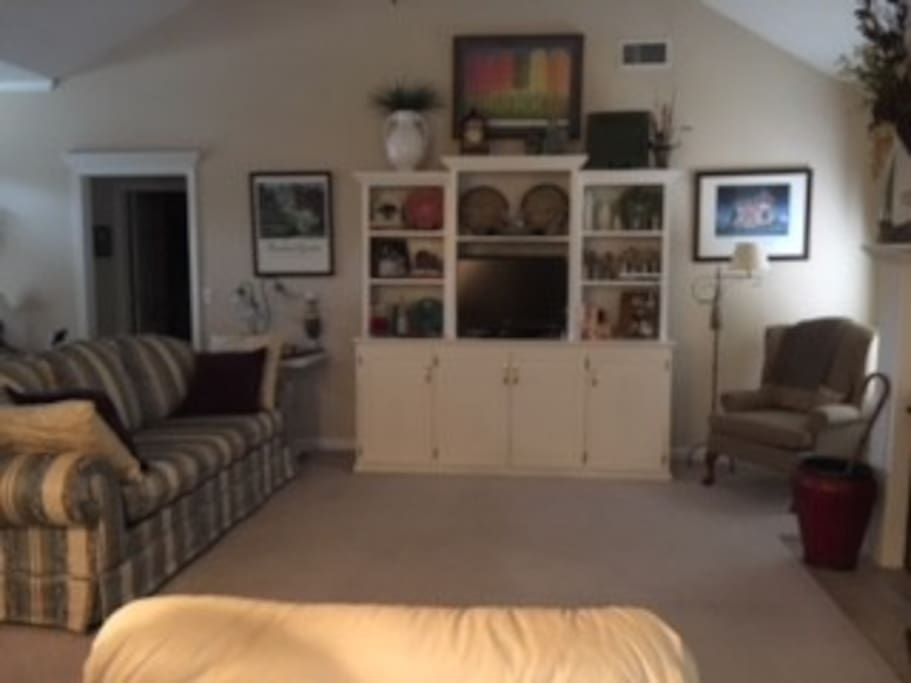 Family room with 2 recliners, chair and sofa  TV has cable