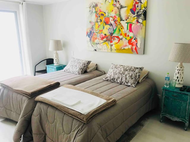 The bedroom with 2 beds, it is hugh, and very light with privat bathroom and walking closet and private terrace