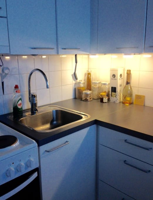 Kitchen also includes a microwave and a water boiler.