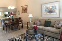 This condo is very cozy, has a great view of the grounds of The Oasis Resort, near one of 8 swimming pools. wonderful patio with BQ