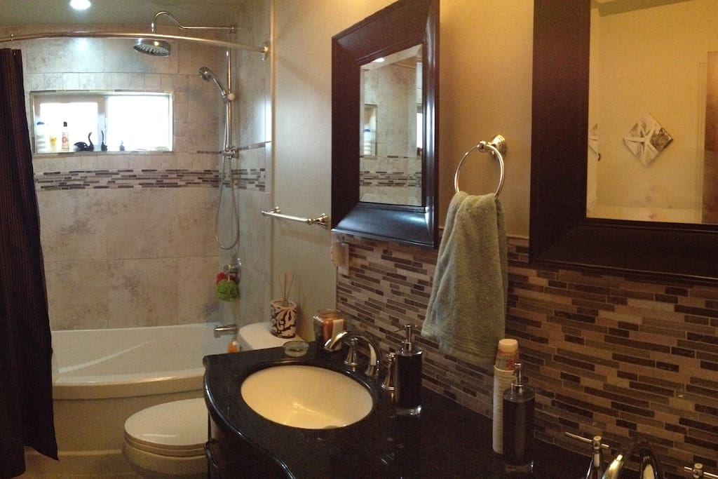 Main Floor Bathroom with Rain shower and Double sinks.