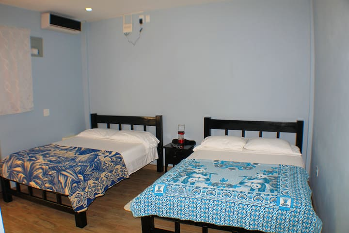 """2 custom-built double beds, 32"""" flat screen TV equipped with HD cable channels, air conditioning, ceiling fan,  Shared bedside table, iron and iron board, coffee maker, microwave, small table with 2 chairs, a place to hang clothes, window."""
