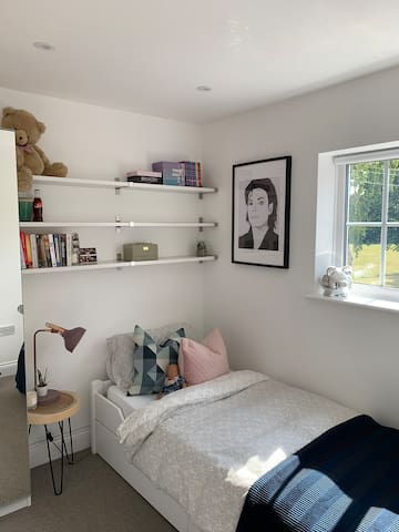 Single bedroom, view of the cricket green.