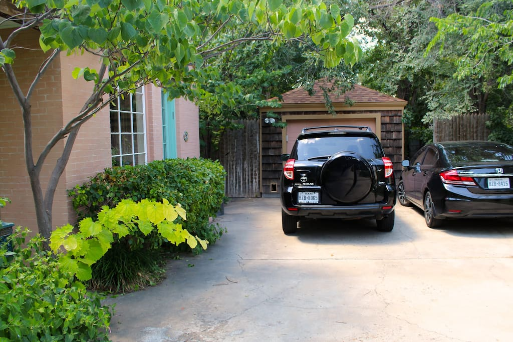 Guest access from driveway. The gate to the back yard is located to the left of our garage.