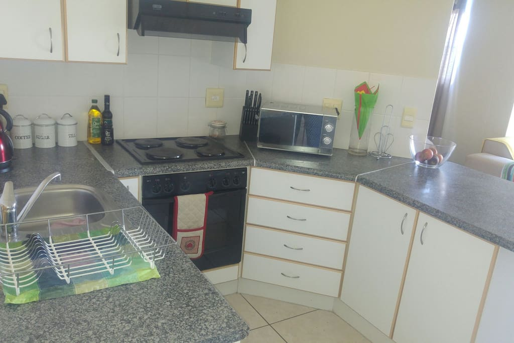 Kitchen with all the basic crockery, cutlery etc. Apartment is walking distance from shopping mall.