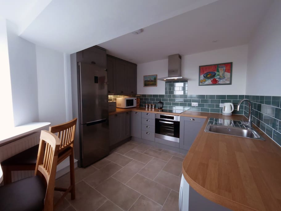 New kitchen and appliances and breakfast bar with sea views