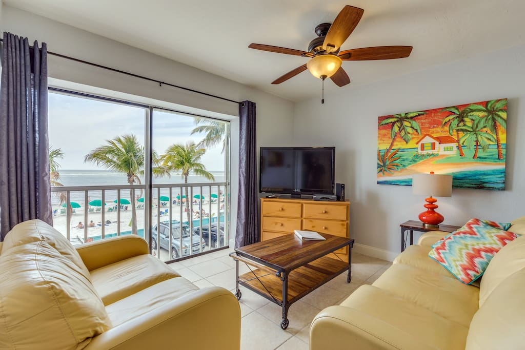 Living room has a sofa sleeper with great Fort Myers Beach views
