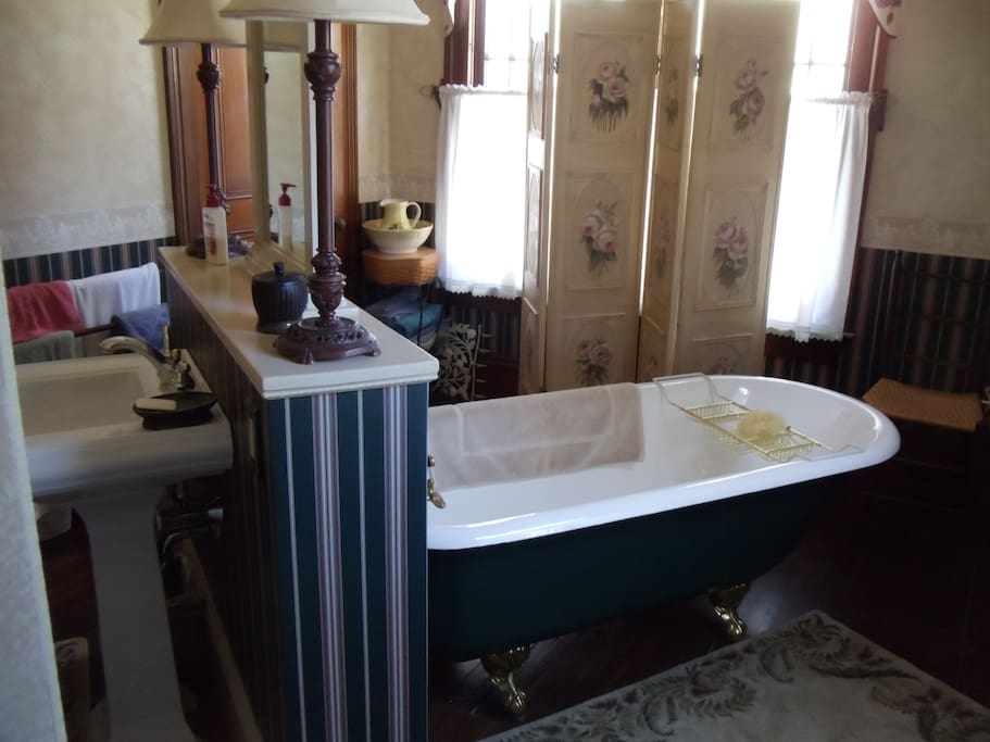 On suite private bath with 6 ft claw foot tub and shower.