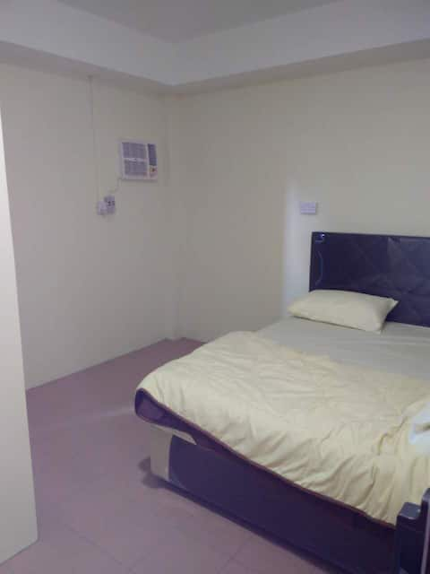 Private room on quiet street in central location.