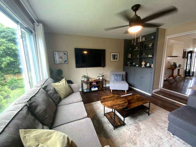 Another view of the living room! The small gray chair pulls out into a Twin Size Sofa Bed. There are zippers that hold in the sofa bed legs. Unzip and lay out the sofa chair!