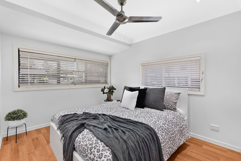 Master Bedroom -  Queen bed with walk in robe and ceiling fan